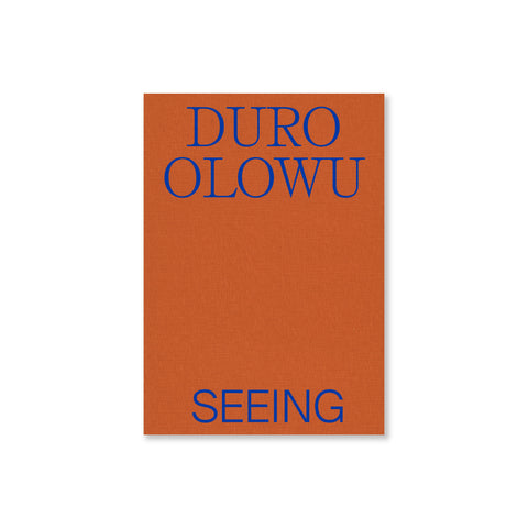 Book cover featuring a textured orange colored background, the name of the author of the book in a royal blue.