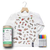 White, long-sleeved, kid's Insect Color-In Shirt with the torso covered in line-drawing illustrations of insects that have been colored in, on a wooden hanger, next to a cardboard tube package and a set of six markers.