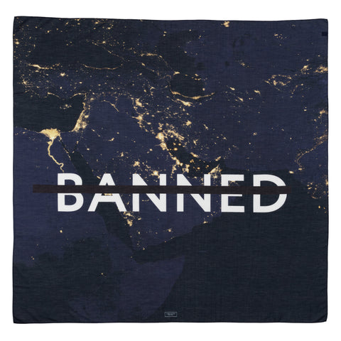 Square textile features a starlight photo of land at night. The center decorated with crossed BANNED in white font.