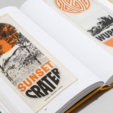 "Interior spread of ""Parks"" featuring two scanned brochure covers featuring black and orange graphics with a 70s feel. Text on the left page brochure reads ""Sunset crater"""