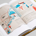 "Interior spread of ""Parks"" featuring an unfolded map with a bright, graphic coastline and illustrations of sea creatures and landmarks, amongst paragraphs of small unreadable text."
