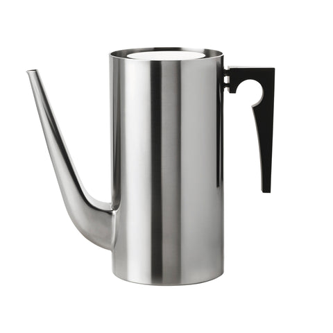 Cylindrical steel vessel with a long, trunk-like spout curving up from the bottom of the vessel. It has a flat top with space around the edge, and a black handle. Handle's outside edge is a right angle and the inside edge is a curve with a circle cut into it.