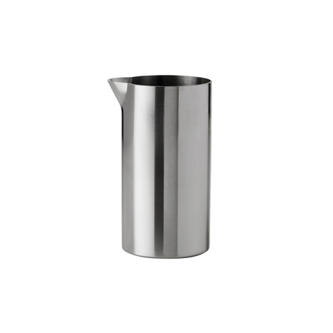 Cylindrical, steel Creamer with a small spout at the top edge. Sides are straight and thin.