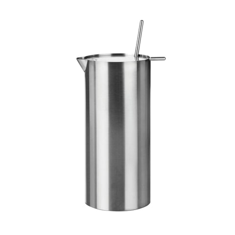 Tall, cylindrical steel martini mixer with a small spout at the top edge, and flat lid that has a mixer protruding from a small opening and a narrow protrusion for flipping the lid open..