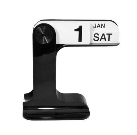 On a footed black stand with rounded edges a raised arm extends out to right.  From a fixed point off the center post, three overlapping white panels join together to form a calendar displaying the date, month and day of the week. Pictured here is SAT, JAN 1.