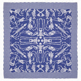 Indigo blue square textile covered in an off-white pattern of human and animal skeletons, the pattern repeats in cardinal directions. The skeleton pattern is bordered by a checkered pattern along all four edges.