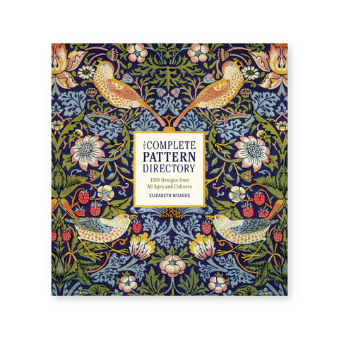 Cover of The Complete Pattern Directory featuring a floral print illustration that includes various fruits and birds throughout. The illustration is set against a navy backdrop.