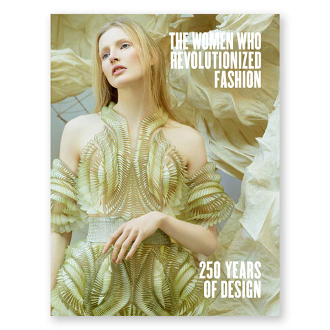 Book cover featuring a white woman off-centered to the left, with long blond hair, glancing over to the left side of the book with her head tilted toward the same direction. Her body faces forward, dressed in an futuristic-like halter gown, which blends with her hair color. The background is a large flowing fabric which also is similarly colored to the gown and hair of the model. The title is in white text in the top right corner
