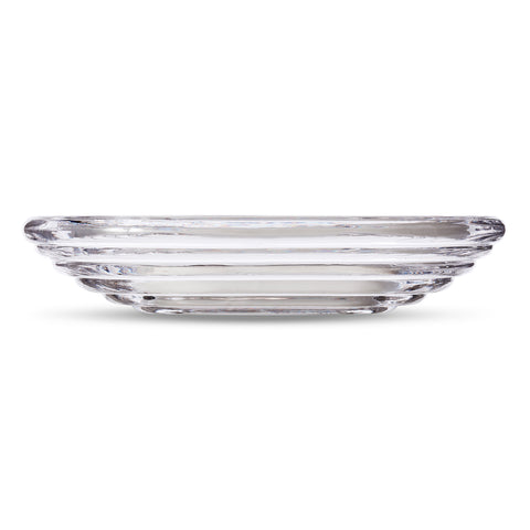 Wide, ridged glass bowl in profile, made up of six, bulbous rings receding in size.