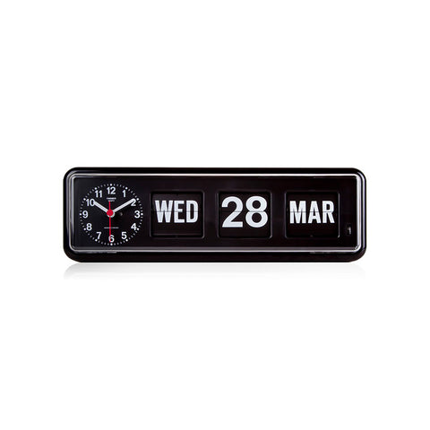 Front view of the BQ-38 Calendar Flip Alarm Clock in Black. The clock is long and rectangular, with rounded corners. It is cased in a shiny black material, with a clear window enclosing the black clock/calendar face. There are three black flipping sections with white printed text: weekday (abbreviated), date (in larger font), and month (abbreviated). To the left of the flip calendar there is a white printed analog clock with with white hour and minute hands, and a red seconds hand.