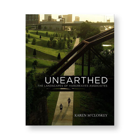 Book cover with photograph of a landscape with deep green grass angular hills and steel bridges. Title overlaid in white sans serif letters