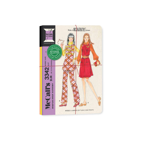 Stack of three notebooks bound with twine; showing vintage misses pattern with two women featuring plaid tunic and pant set and red jumper.