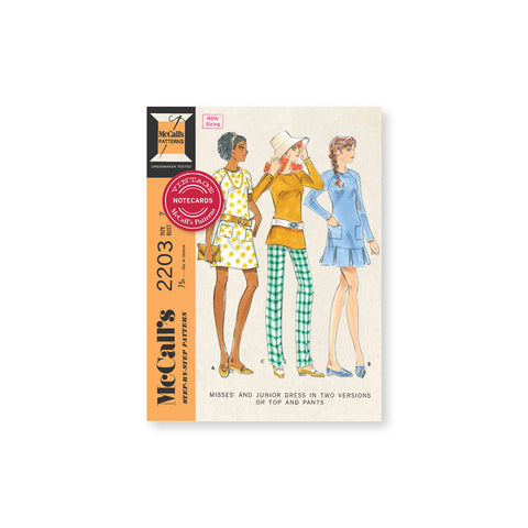 Top of notecard set using vintage misses pattern. Three ladies featuring two style dressed and one tunic and pant set in warm tones.
