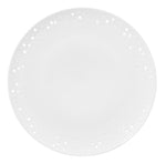 White, wafer-thin saucer on a white background, glazed porcelain with irregularly pierced edges inspired by the sensuous appearance of sun-bleached coral.