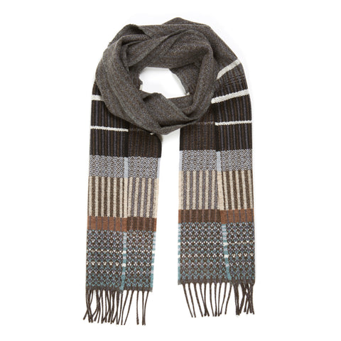 Kyoto Lambswool Scarf arranged on a white background, looped as though casually worn about the neck. Grey with grey fringe and accents of brown, cream and teal woven in an array of zigzags and pinstripes.