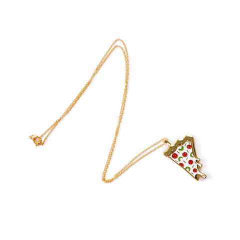 The enamel Pizza Pendant on a gold chain. The pendant is a slice of pizza with a gold crust, covered in a white, dripping cheese with red pepperoni and green peppers.