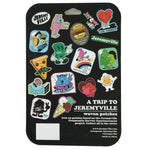 "The back side of package showing examples of the available designs. Against a black background the brand name ""A Trip to Jeremyville"" is embossed at the bottom right corner in white with company details below."