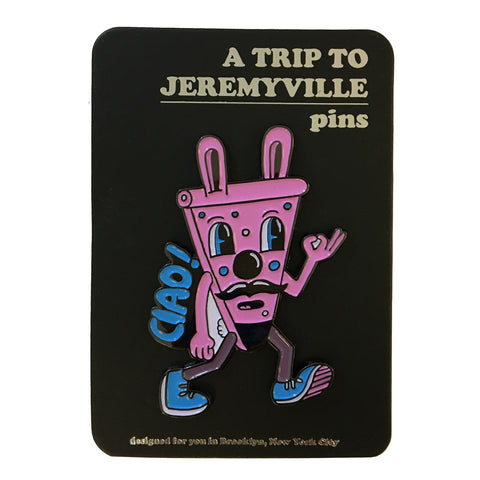 "Inside a blister back, a pin of Jethro as a slice of pink pizza with ""Ciao!"" up his left side. ""A Trip to Jeremyville"" is embossed at top."