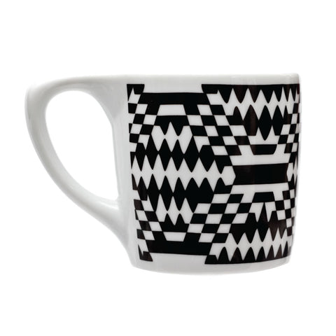 White and black checkered patterned coffee mug