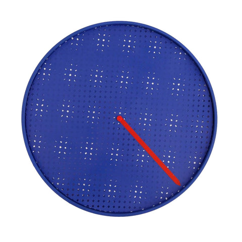 Close-up of the primary blue Milton Glaser Presto Clock on a white background. The large perforated blue face slowly rotates over a pattern of white squares to reveal the hour, while the minutes are indicated by the red hand.