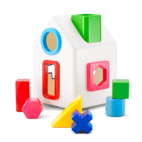 Toy house with various shaped holes for inserting matching shapes that come in various colors