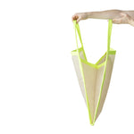 Side view of a large triangle-shaped bag with natural colored body and neon yellow trim.
