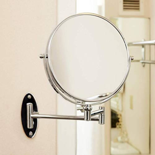 "Conair 8"" Diameter Wall Mount Mirror adjusts to any angle for easy viewing, and has a stylish and durable chrome finish. One side of the 41741W is a regular mirror, and the reverse side provides 5X magnification - C-41741W"