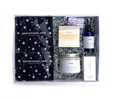 Boxed gift with space masks, lavender pillow spray, mineral bath salts, calamine facemark and scented tea lights