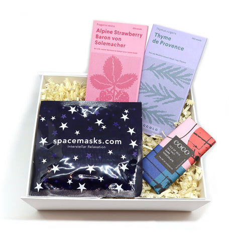 Gift box with strawberry and thyme seeds, a self-heating eye mask and sea salt dark chocolate