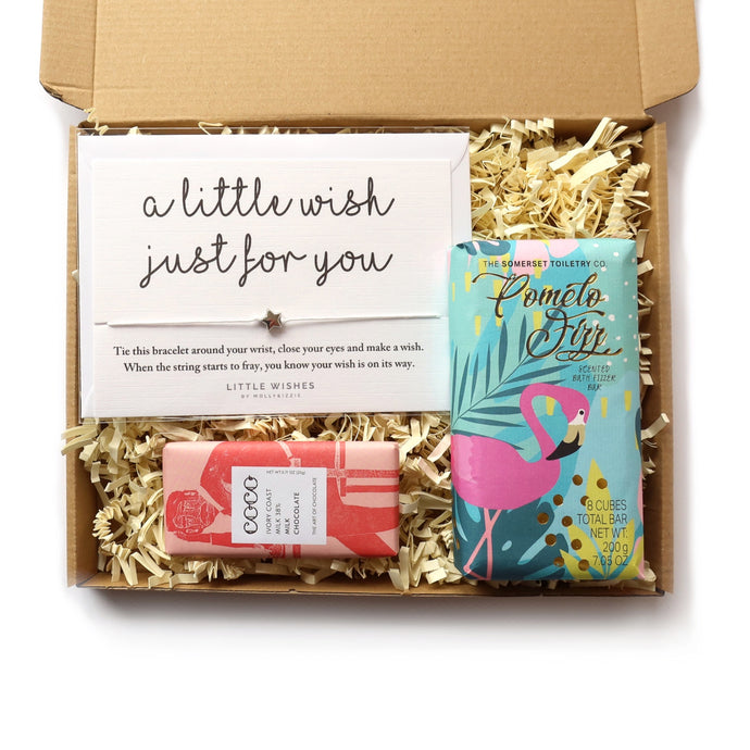 Letterbox gift set containing a bracelet just for you, pomelo fizz scented bath fizzer and a mini bar of milk chocolate.