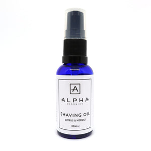 Alpha Grooming citrus and neroli shave oil in a blue bottle with white label