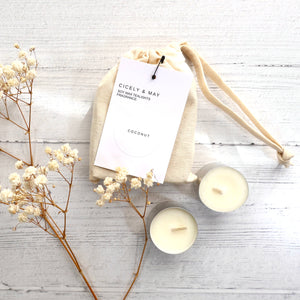 Cream linen bag with coconut scent tea lights and white label