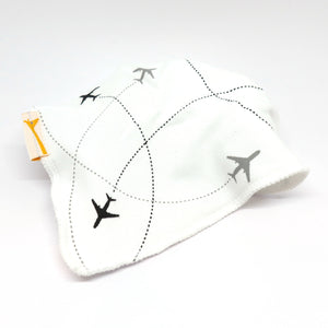 Baby's white bandana bib with black and grey aeroplane pattern.