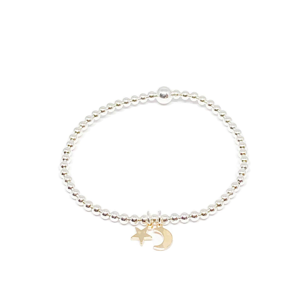 elasticated beaded silver bracelet with gold moon and star charm