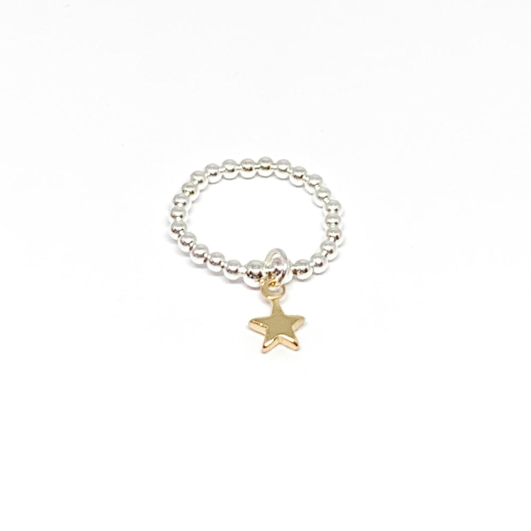 Elasticated silver beaded ring with a gold star charm