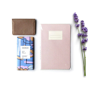 Teen girls gift set including rose gold leather travel wallet, notepad and chocolate bar