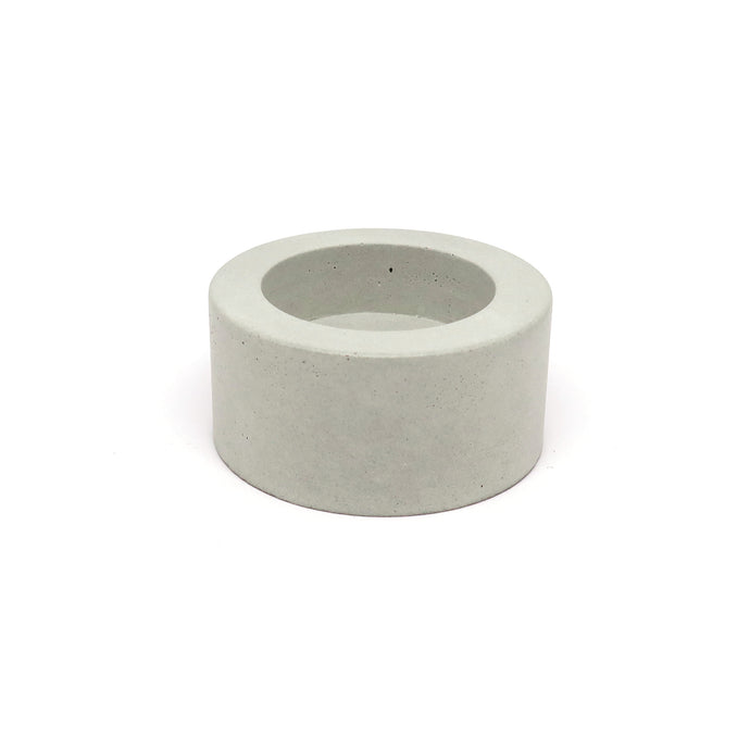 grey concrete tea light holder on a white background