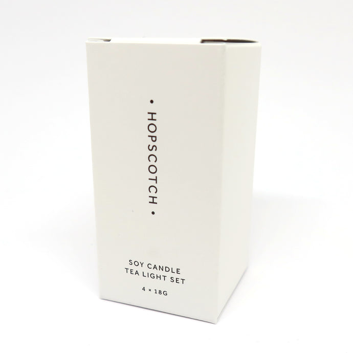 White box with four scented tea lights inside by Hopscotch London