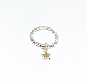 Silver bead ring on stretch elastic with a rose gold star charm