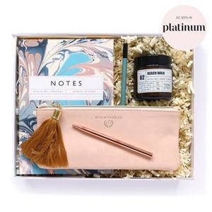 Gift set includes luxury marbled notepad, pen, pencil, scented candle and blush pink zip pouch