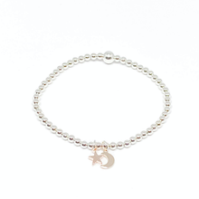 Load image into Gallery viewer, silver bead bracelet with rose gold mini moon and star charm
