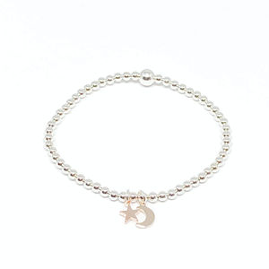 silver bead bracelet with rose gold mini moon and star charm