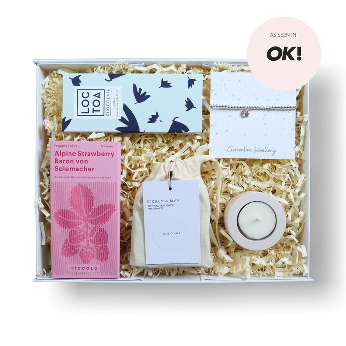 Luxury gift box filled with tea lights, tea light holder, strawberry seeds, milk chocolate and a bracelet