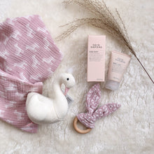Load image into Gallery viewer, New baby gift flat lay showing muslin, teether, swan rattle and baby balm
