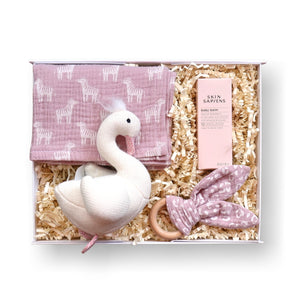 New baby gift box filled with muslin, teether, swan rattle and baby balm