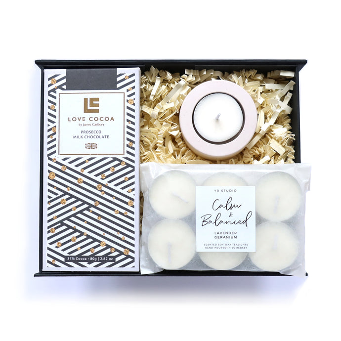 Gift box with Prosecco chocolate, calm and balanced tea lights and a concrete tea light holder