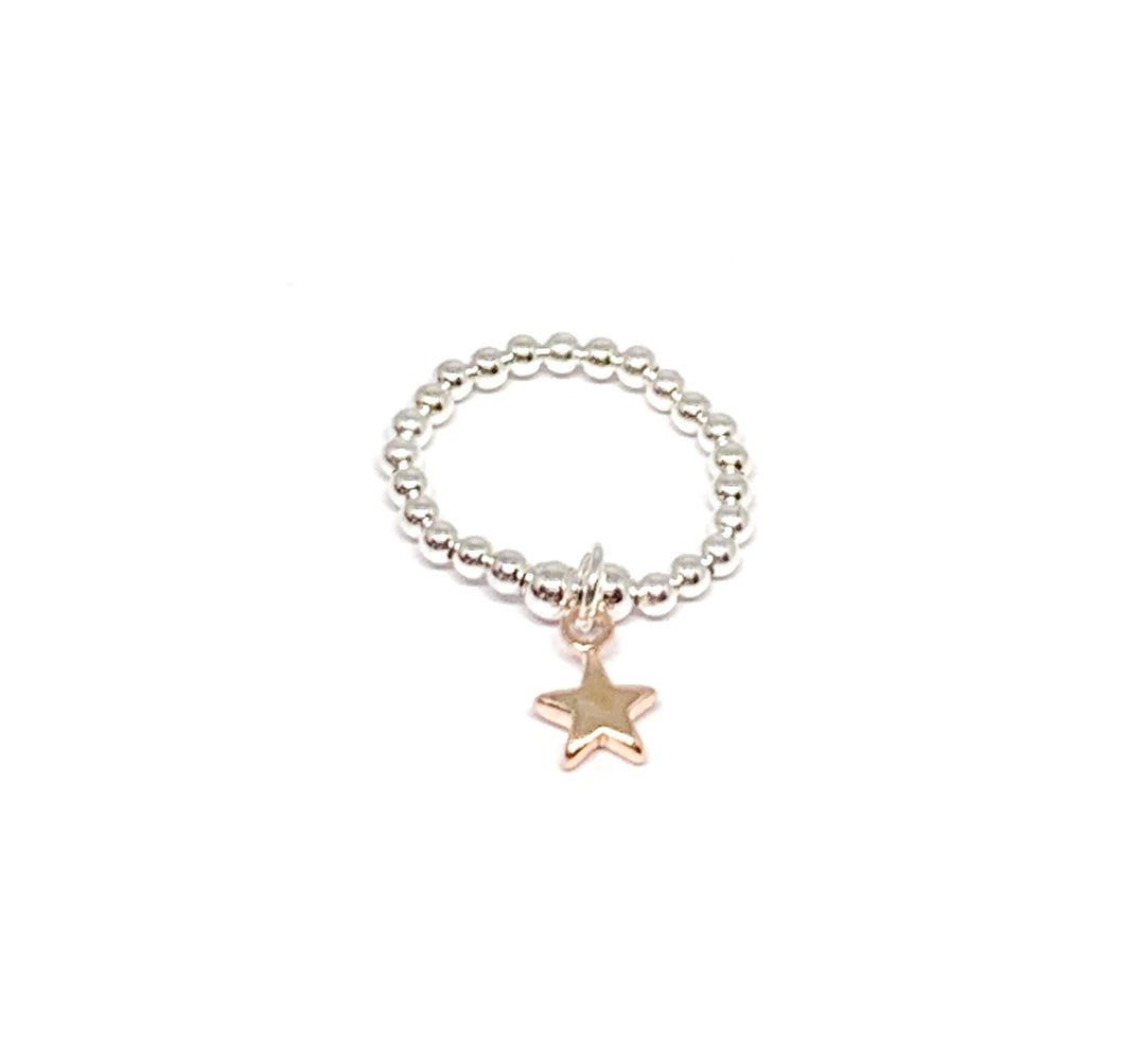 silver beaded ring with a rose gold star charm