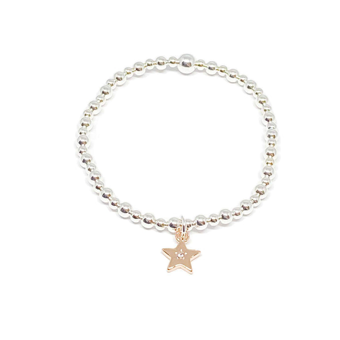 elasticated silver beaded bracelet with a rose gold star charm with diamond