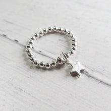 Load image into Gallery viewer, Silver beaded ring with a silver star charm