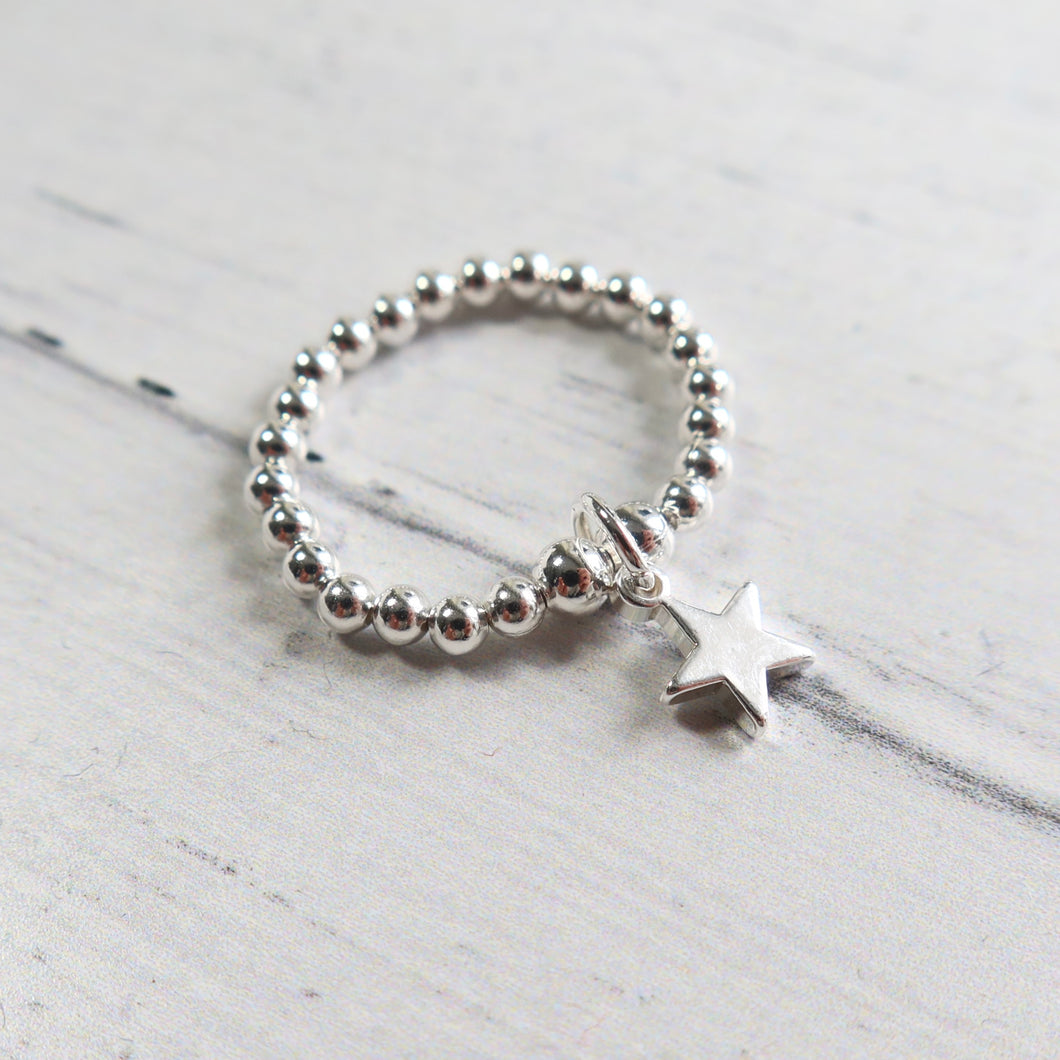 Silver beaded ring with a silver star charm